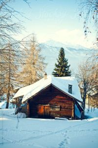 Wooden cabin in the snow in the mountains